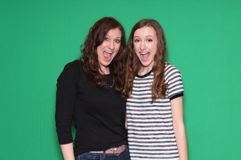 Photo booth guests in front of chroma key green backdrop